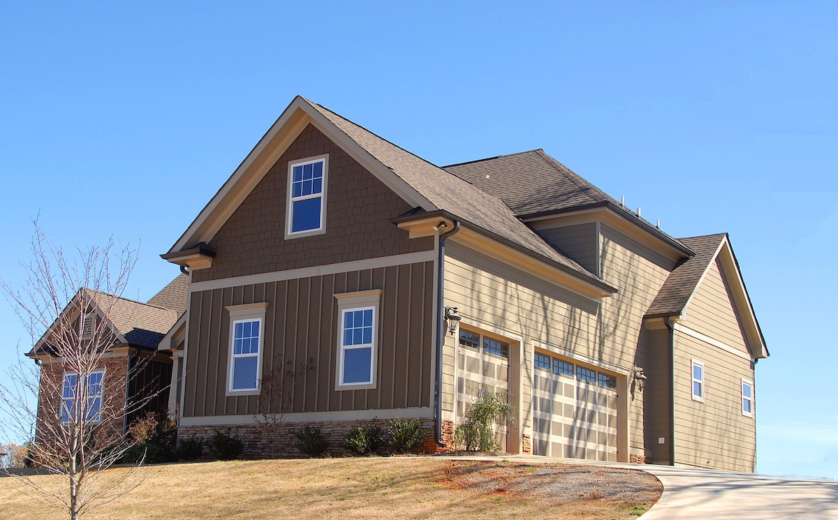 You could move into a home similar to this beautiful brown 2-story home with Cami Jones & Co.