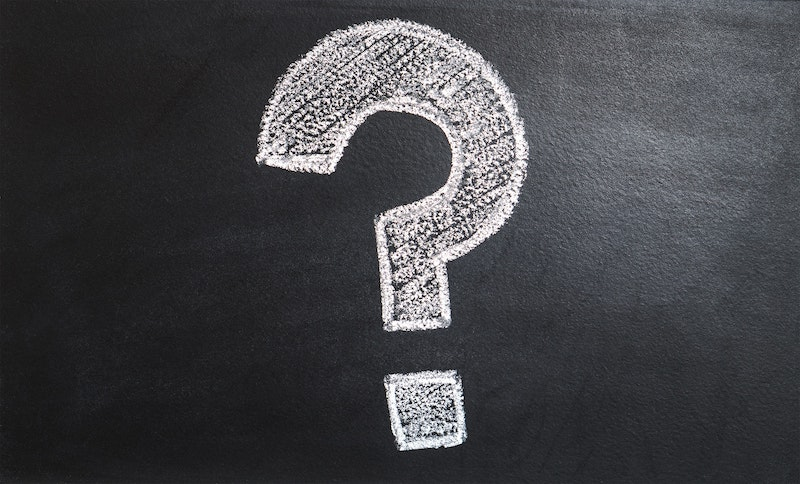 This white question mark symbolizes the questions you need to ask your real estate agent.