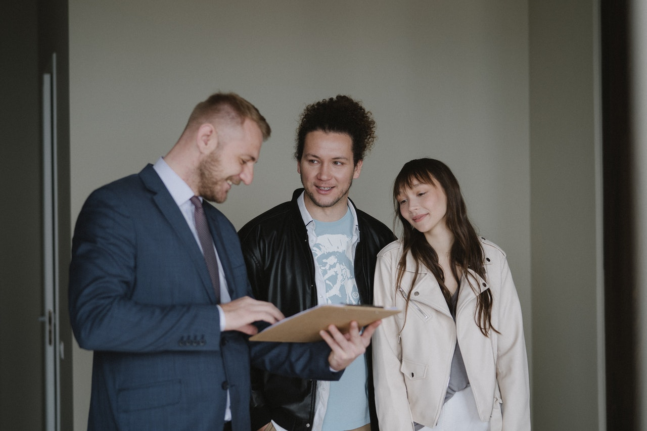 Real Estate Agent With Home Buyers